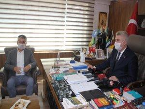 Ak Parti Kayseri İl Başkanı Çopuroğlu'ndan MHP'ye hayırlı olsun ziyareti