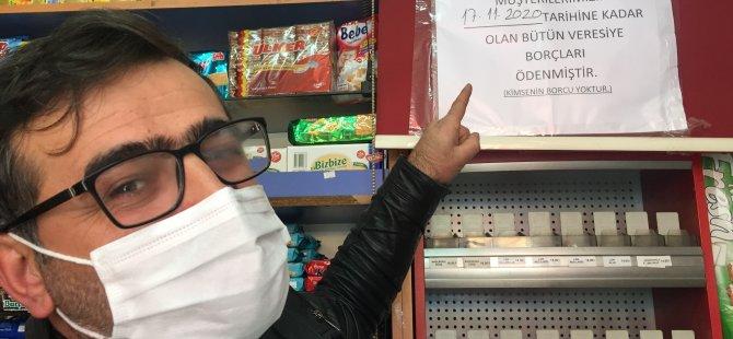 Kocasinan'da İki hayırsever bakkal defterini satın aldı