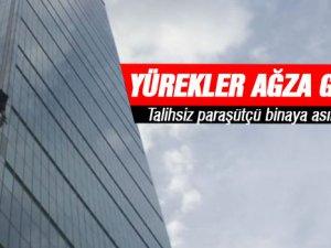İstanbul Sapphire'den paraşütle atlayan bir sporcu orta katlardan birinde asılı kaldı.