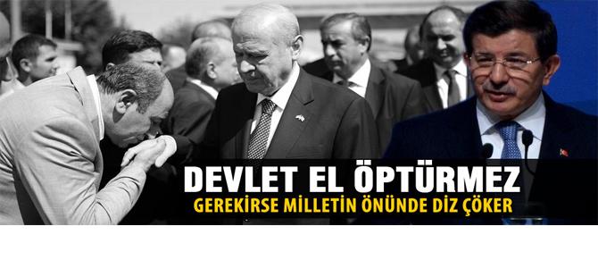 Davutoğlu'ndan Bahçeli'ye el öptürme tepkisi