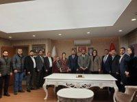 MHP'DEN AK PARTİ MELİKGAZİ İLÇE BAŞKANI ÜLKE'YE ZİYARET